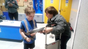 Playing at being a delivery man at Kidzania.