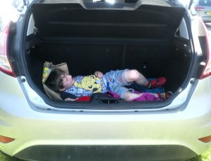 Noah has a nap in the boot of the car