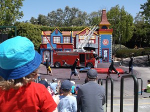 Noah watching the fire station show at Legoland.