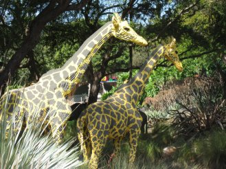 Giraffe sculptures made of Lego.