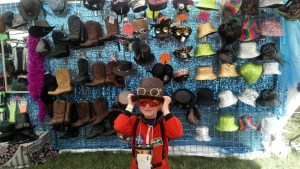 Noah tries on hats at Leeds Festival.