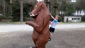 Noah plays on a life size model of the story book character, The Gruffalo.