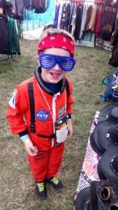 Noah's in his astronaut suit and funny glasses.
