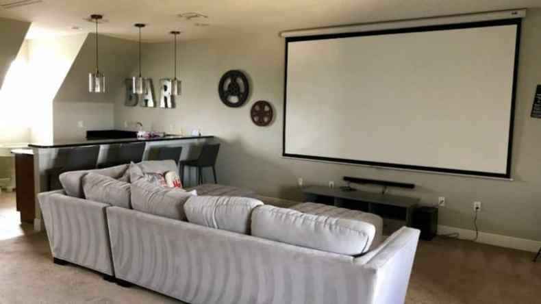 Looking for where to stay in Orlando, this movie room inside a vacation home was a huge hit with our family.