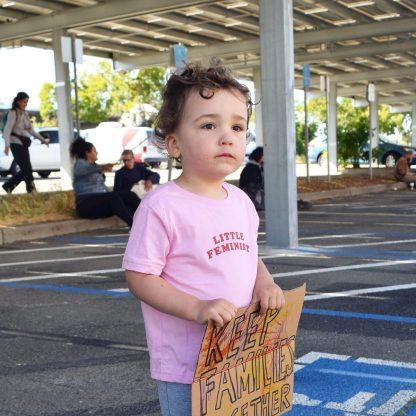 Little Feminist pink kid's shirt in action