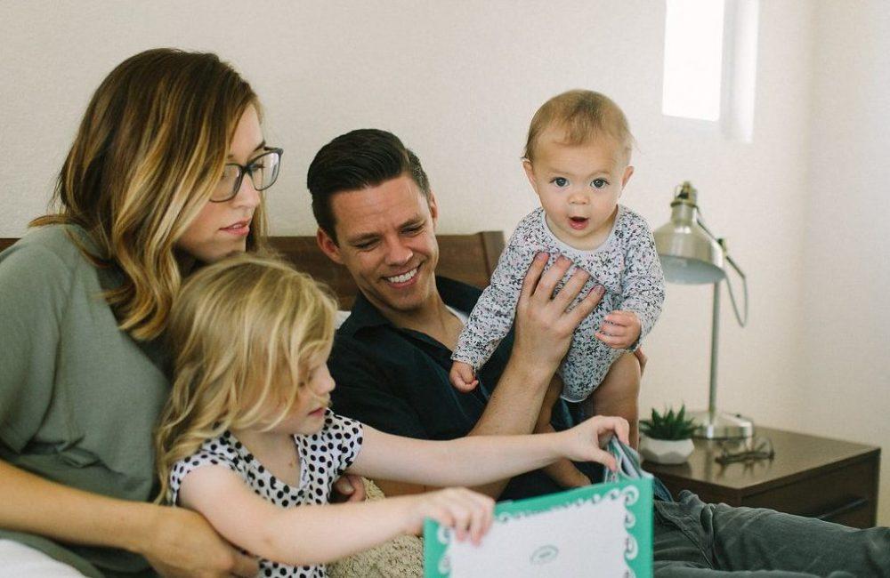 Family reading classic feminist children's book