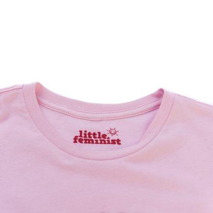 Raising Feminists pink adult shirt inside label