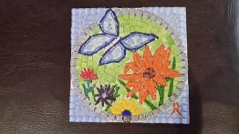 This is a sample I'm working on for the Butterfly Project for LFCT ... needing grout. The gold ribbon is for childhood cancer and the little angel is on all our projects for the Magalies Mosaic Morning Angels
