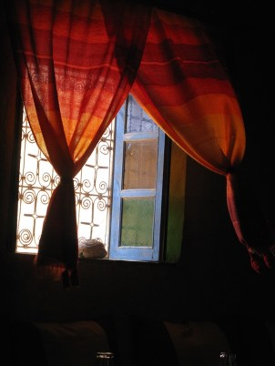 Window & billowing curtain, Morocco