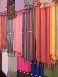ColourfulStriped shawls & scarves hang for sale