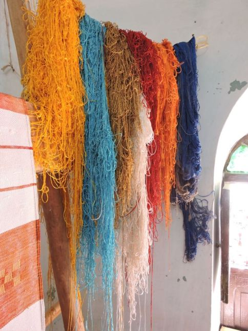 Multi-coloured hand-spun silk hanging in a Moroccan rug weaving cooperative