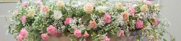 Photo of flower arrangement on font
