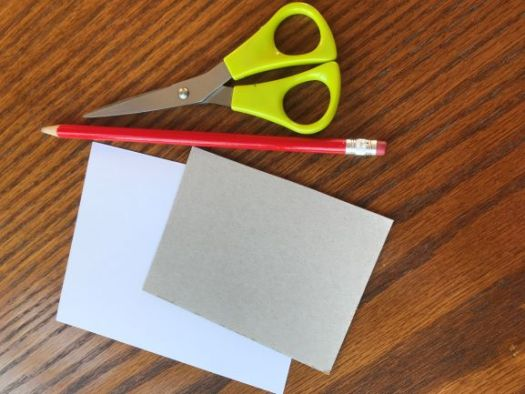 Photo of card, pencil and scissors