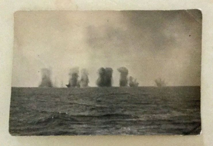 "A photograph taken from the Ark Royal entitled ""attacking the Bismarck""."