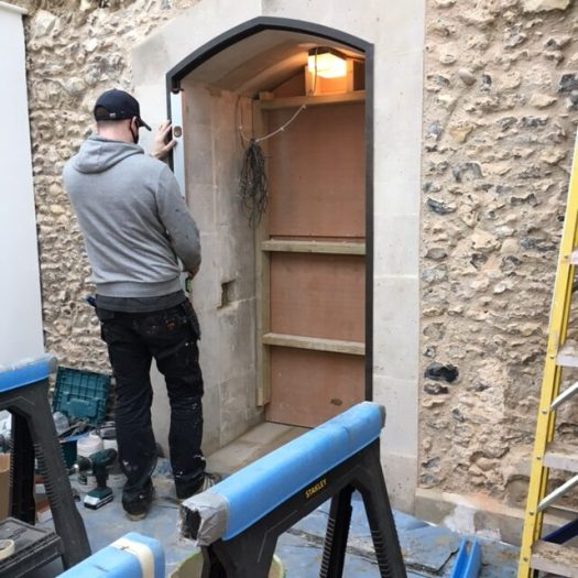 Photo of building works - fitting the bronze door