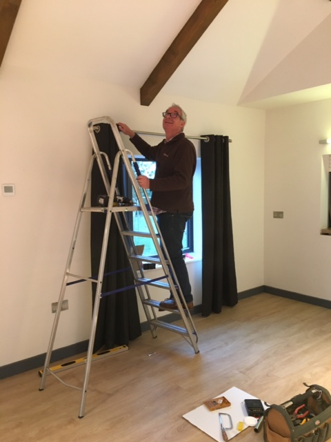 Photo of Thomas Field Hall: installing curtains