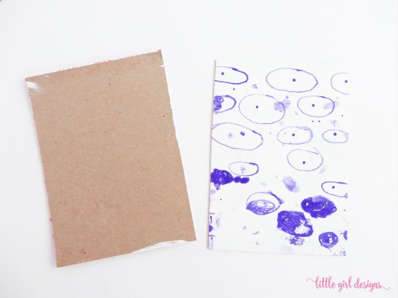 We painted the art journal cover with white acrylic paint and my daughter decorated it with a purple gelly roll pen. She was excited to have her own drawing notebook.