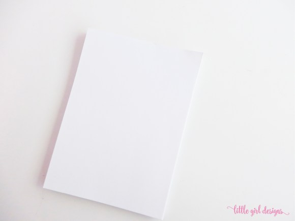 I let my husband cut the copy paper to size for this easy sketchbook tutorial.