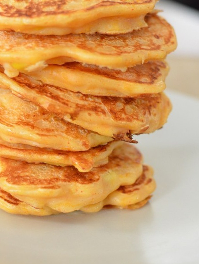 close up of butternut squash and sweetcorn pancakes stack