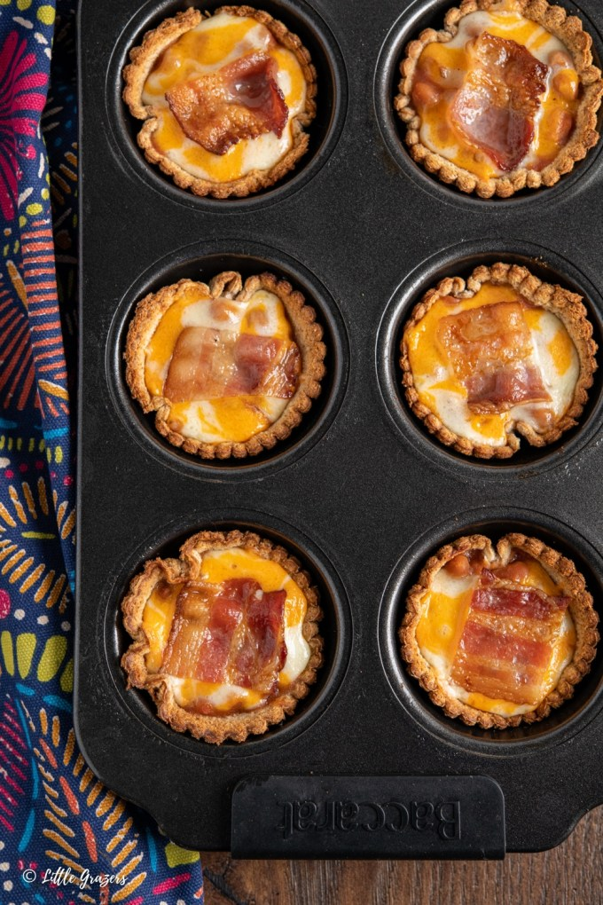 bacon baked bean cheddar toast cups in muffin tray