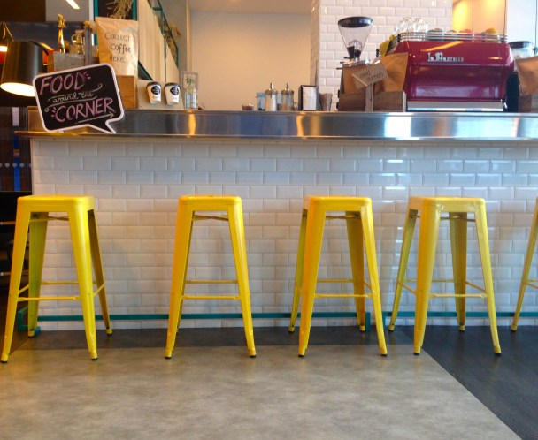 Tune Hotel yellow chairs cafe
