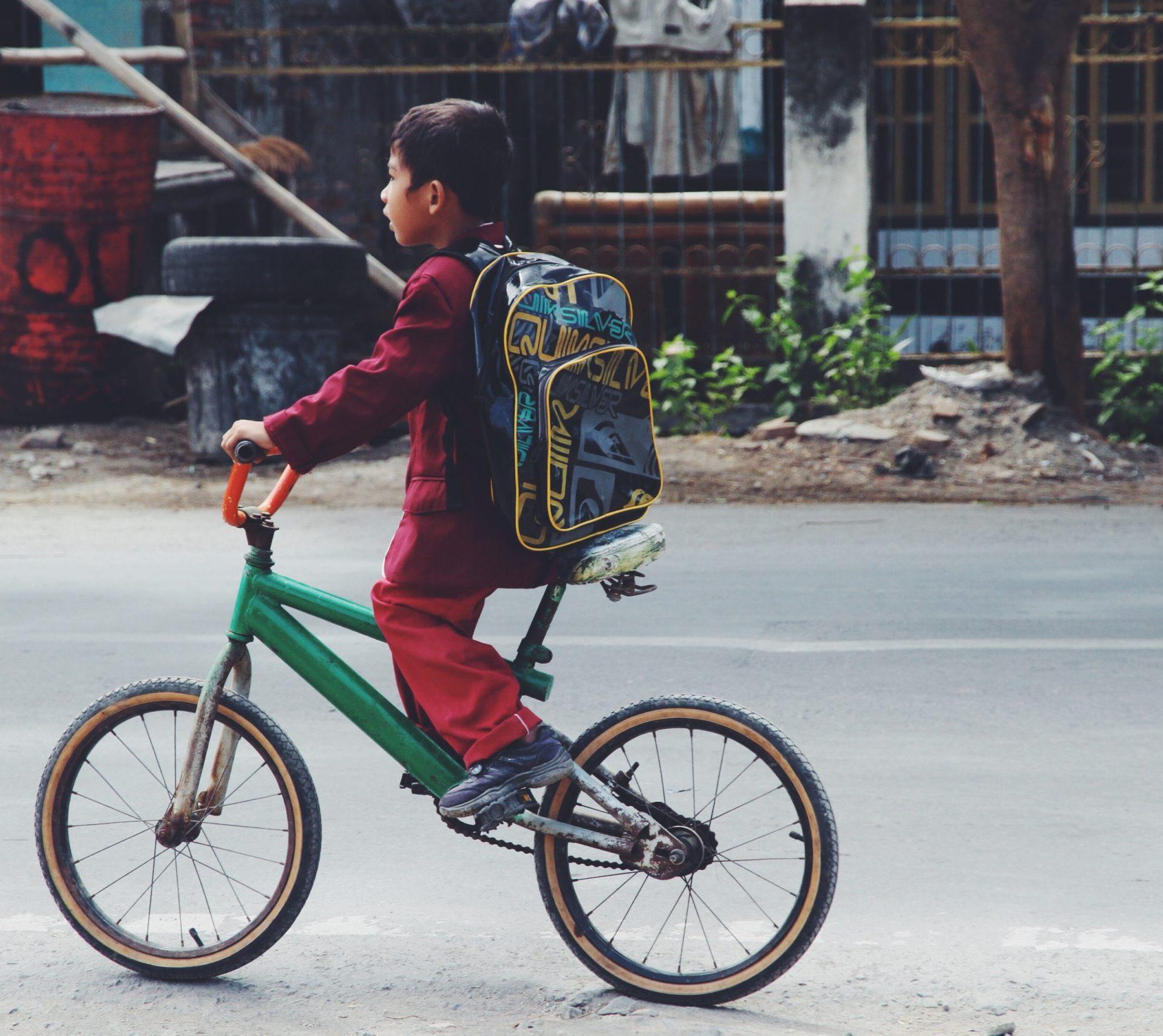 Local child on a bike