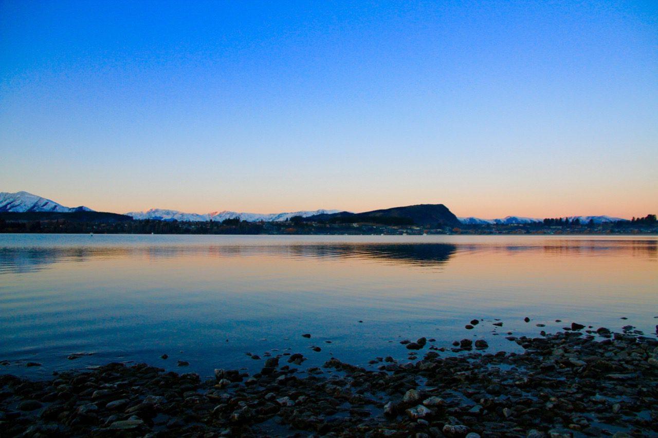 Lake Wanaka things to do in Wanaka sunset blue and orange travel blog