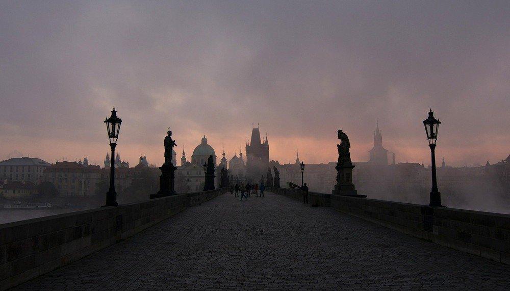The eerie beauty of Prague's Charles Bridge at dawn.