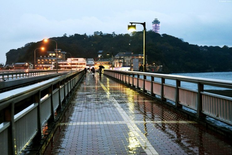 To get to Enoshima island, cross the long bridge over the sea. Look to the right for a view of Mt. Fuji.