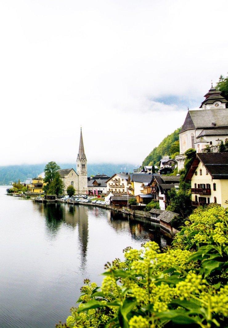 A postcard-perfect photo of Hallstatt, Austria's most beautiful town. Click through for a comprehensive Hallstatt travel guide.