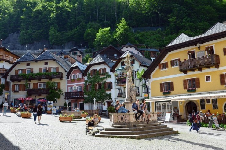 Hallstatt's market square with its pretty pastel buildings brings the town's locals and visitors together.