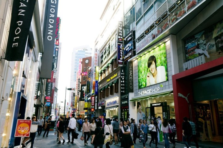 Where to stay in Seoul - Myeongdong is Seoul's shopping central. You can easily spend a week prowling the sparkly streets of Myeongdong and you won't run out of things to buy or try.