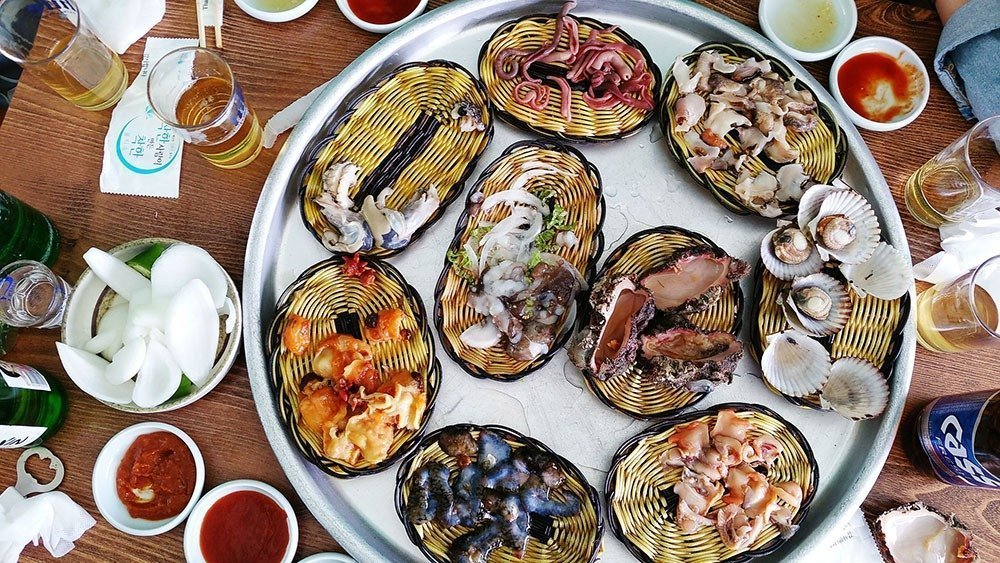 Seafood and soju makes for the best meals in Busan! Enjoy this staple diet right by the sea and bask in the beauty of Busan's natural landscapes. Plan your trip to this amazing summer destination - here's where to stay in Busan.