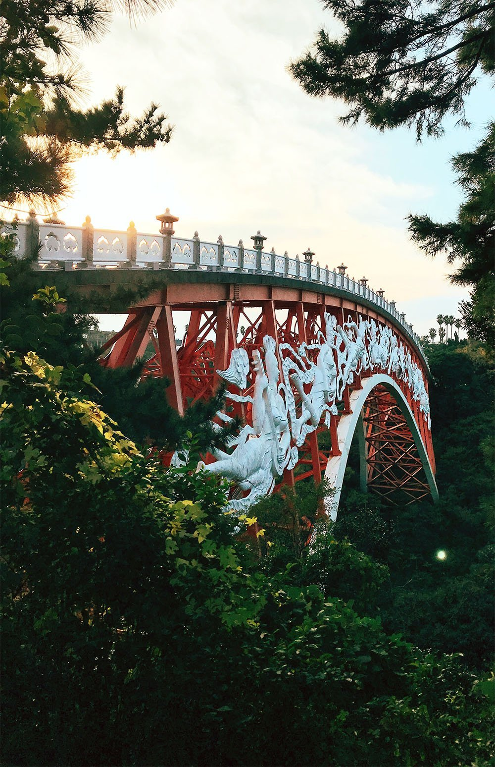 Cross the Seonigmyo bridge from the Jungmun Tourist Center to Cheonjeyeon waterfalls.