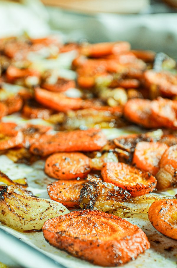 The humble carrot is roasted with onions and sprinkled with a brown sugar and cinnamon mixture for a delicious result!