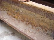 Close up of rail with rust scale and concrete