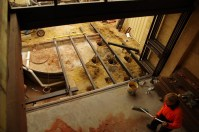 Get the joists and bearers level, bolt on the stirrups and then set in concrete - guaranteed to get them level