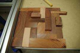 Working out the puzzle of how to fit a dozen or so random slices of off-cut timber into a 325 mm square