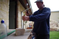 Getting the old chisel out to get a chunk of beeswax off the block