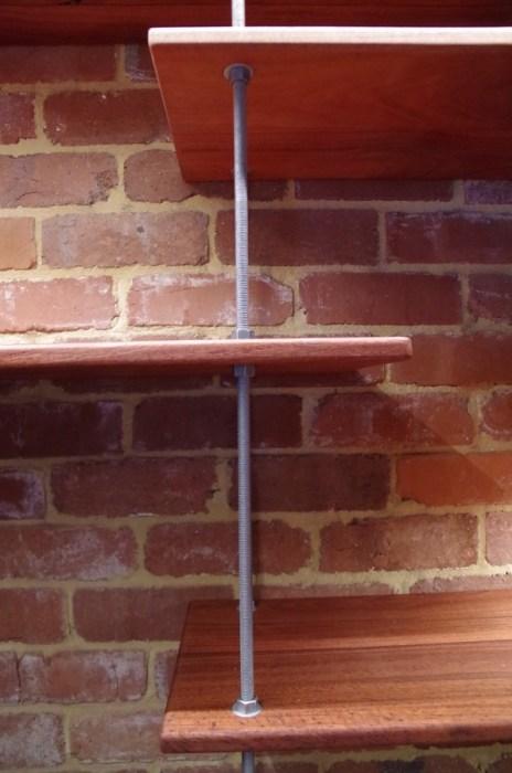 Threaded rod holding up the shelves