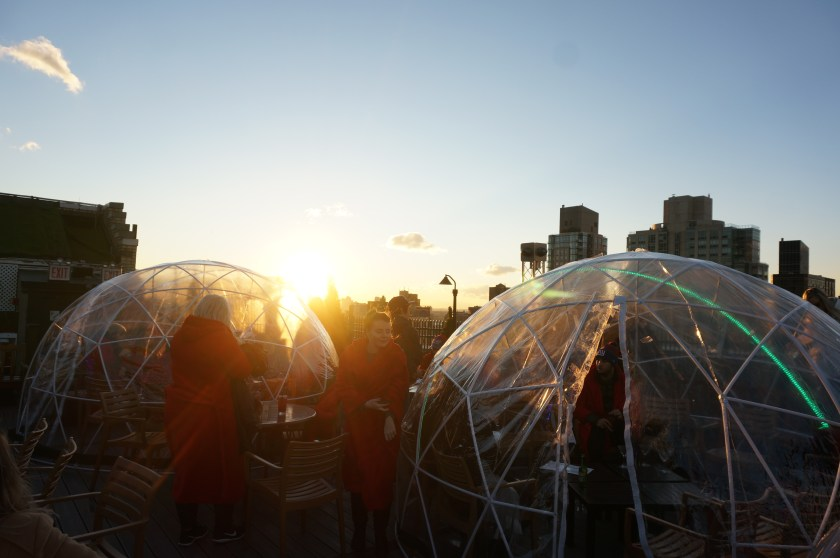 Sunset over an igloo on 230 Fifth Rooftop