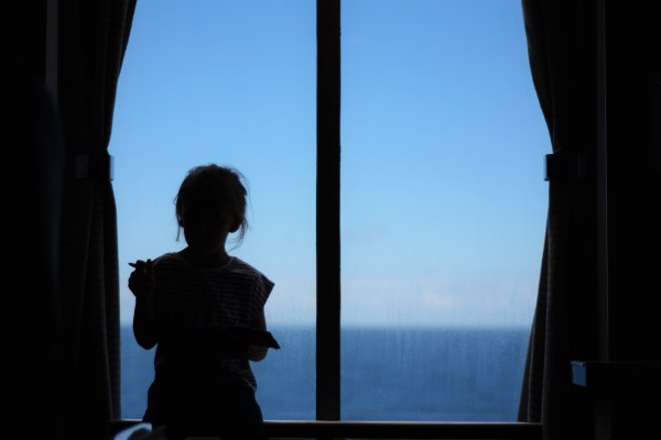 Ferry to France with Children 5 year old silhouette at window