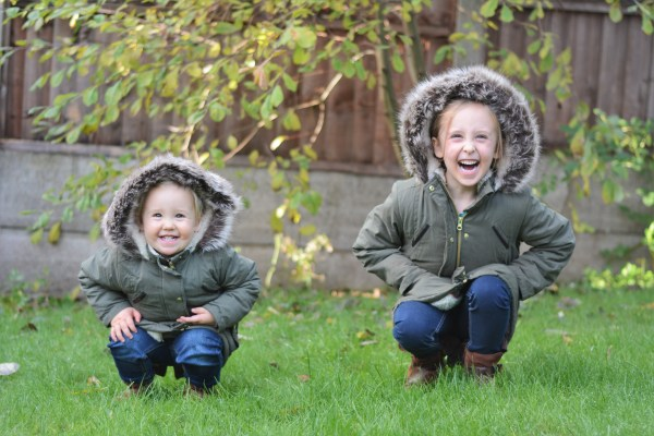 Sisters November in matching coats