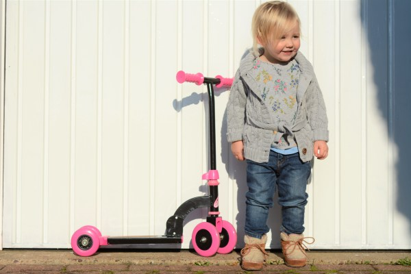 1 year old on a scooter