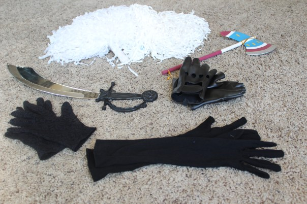 gloves, plastic sword, pom-poms