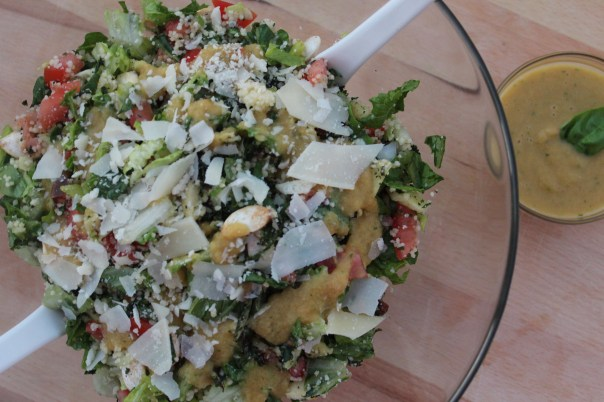 chopped salad, smoked salmon, kale, roasted parsnips, romaine lettuce, tomatoes, couscous, basil peach vinaigrette