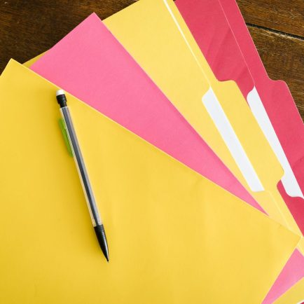 colorful folders and pen on the table
