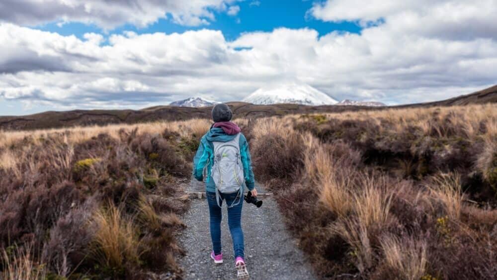 Woman walking through Tongariro National Park in New Zealand
