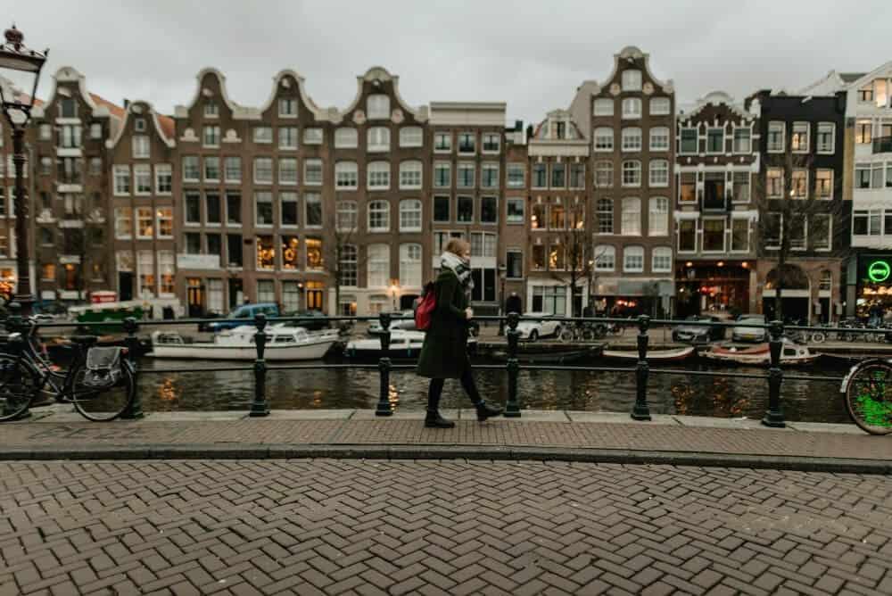 Person walking through Amsterdam in winter