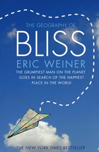 Book cover of The Geography of Bliss with a paper airplane graphic on the front.